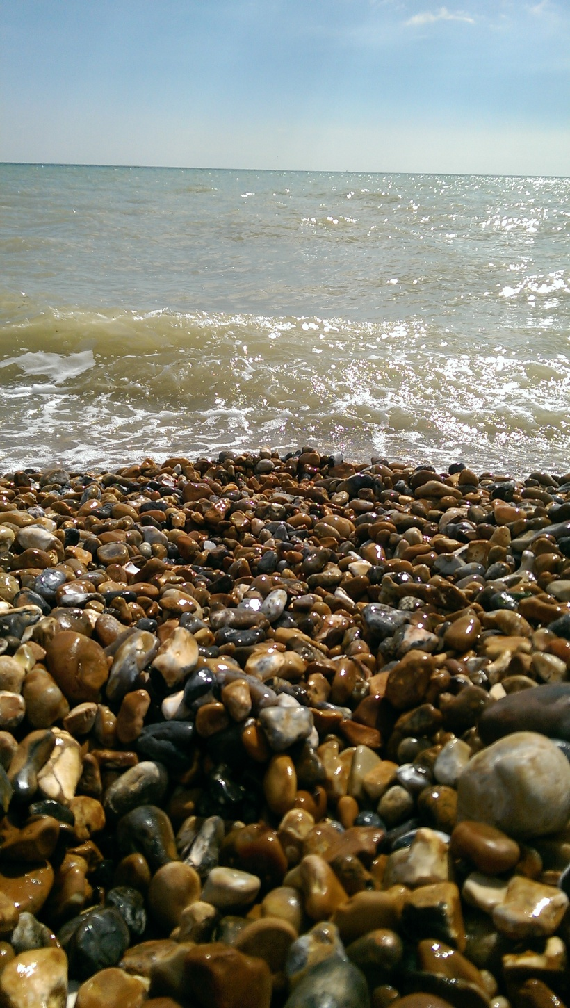 sea, pebbles on beach, south east