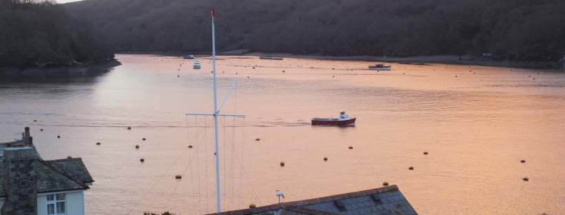 pink sun in fowey, fowey river, estuary, winter